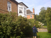 Photo of Miro of M&M Services cleaning domestic windows on a house in Maidenhead